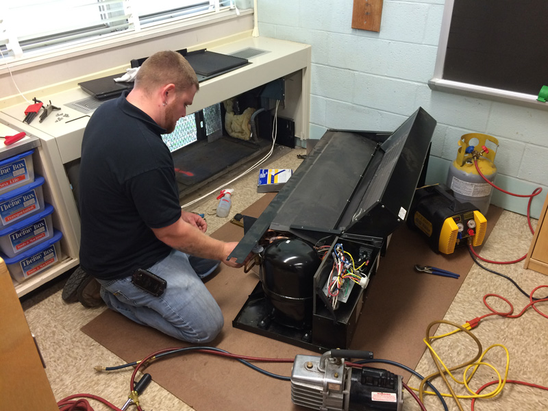 Justin repairing a unit on a service call